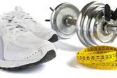Shoes, tape and dumbbell — Stock Photo
