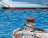 Bollard and water — Stock Photo