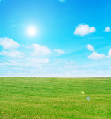 Meadow and clouds with sun — Stock Photo