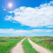 Country road and sun — Stockfoto
