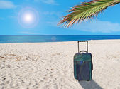 Suitcase and sun — Stock Photo