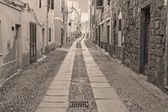 Alghero street in sepia tone — Stock Photo