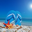 Blue sandals and sun — Stock Photo