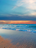 Waves at sunset — Stock Photo