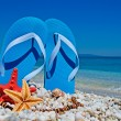 Blue sandals on pebbles — Stock Photo #27850101