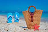 Straw bag and sandals — Stock Photo