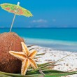 Parasol in a coconut — Stock Photo