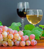 Grape and glasses — Stock Photo