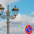 Street light and road sign — Stock Photo