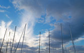 Masts under clouds — Stock Photo