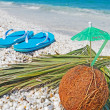 Coconut and flip flops — Stock Photo