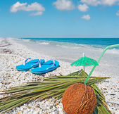 Flip flops and coconut — Stock Photo
