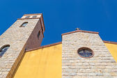 Yellow and beige church — Stock Photo