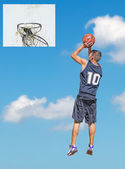Hoop and player in the sky — Stock Photo