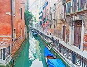 Narrow green canal — Stock Photo