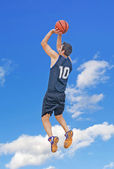 Jump shot in the sky — Stock Photo