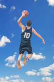 Left hand dunk among the clouds — Stock Photo