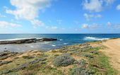 Rocky shore and clouds — Stock Photo