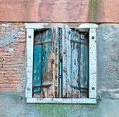 Old green shutters — Stock Photo