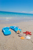 Sandals by the shore — Stock Photo