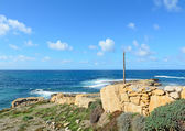 Stone wall by the sea — Stock Photo