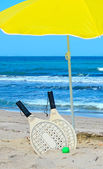 Rackets and parasol — Stock Photo