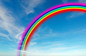 Blue sky with rainbow — Stock Photo