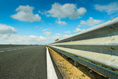 Guard rail and clouds — Stock Photo