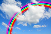 White clouds and blue sky with a colorful rainbow — Foto Stock