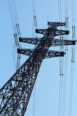 Solitary electricity pylon — Stock Photo