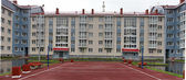 House with a sports ground — 图库照片