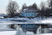 House on the river bank — Stock Photo
