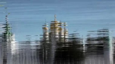 Monastery reflected in river water — Stock video