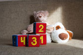 Teddy bear and cubes with number — Stock Photo