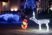 Illumination white deer and Snowman — Stock Photo