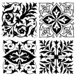 Stock Vector: Four vintage foliate ornament designs