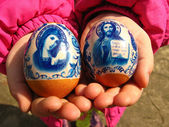 Two easter eggs in the child — Stock Photo