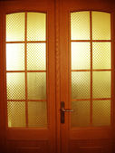 Beautiful wooden door with glasses — Stock Photo