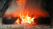 Fire and smoke from the furnace — Stock Photo