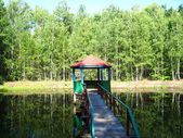 Summerhouse in picturesque place with river — Stock Photo
