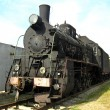 Stockfoto: Ancient black steam locomotive