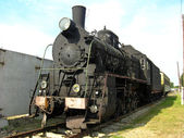 Ancient black steam locomotive — Stock Photo