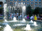 View on summer town with fountain — Stock Photo