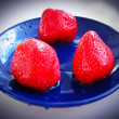 ������, ������: Three ripe strawberry on the blue plate