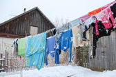 Washing suspended on a cord in winter — Stockfoto
