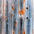 Wooden fence of smoky color — Stock Photo