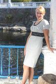 Nice girl standing near the column — Stock Photo