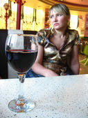 The girl with glass of red wine in restaurant — Stock Photo