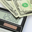 Dollar banknotes and calculator — Stock Photo