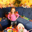 Stock Photo: Little girl playing with toys in her room